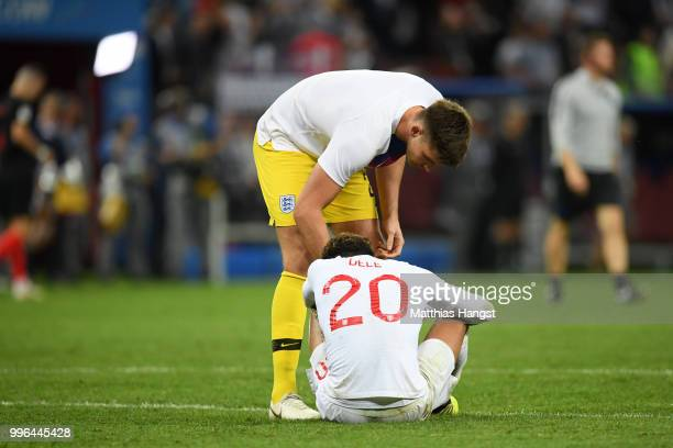 Nick Pope of England consoles Dele Alli of England following their sides defeat in the 2018 FIFA World Cup Russia Semi Final match between England...
