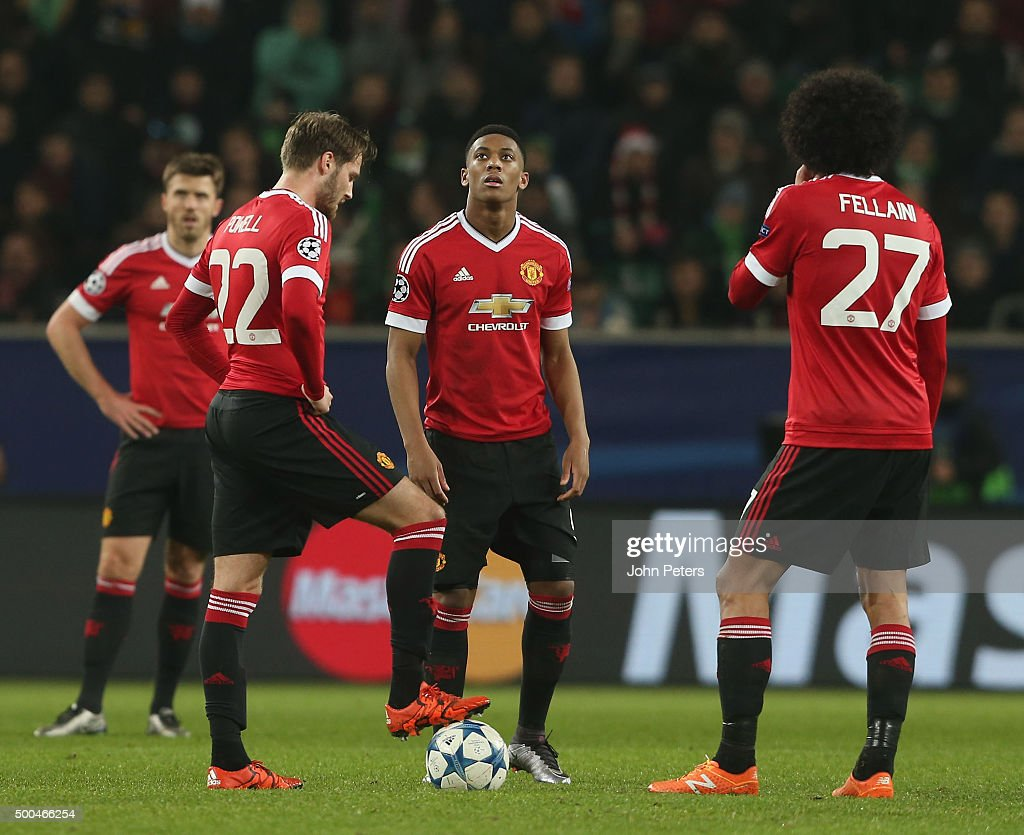 Nick Powell and Anthony Martial of Manchester United show their disappointment during the UEFA Champions League match between VfL Wolfsburg and Manchester United at Volkswagen Arena on December 8, 2015 in Wolfsburg, Germany.