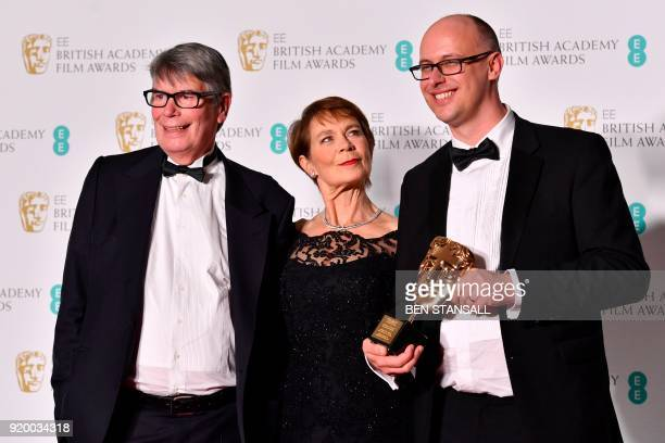 Nick Powell and Jon Wardle pose with citation reader British actress Celia Imrie with the award for an outstanding British contribution to cinema...