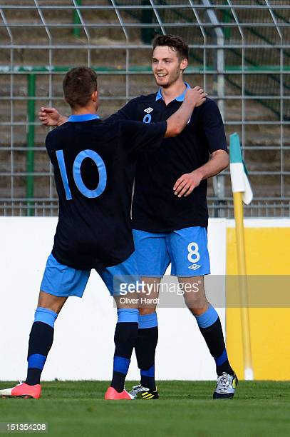 Nick Powell of England celebrates after scoring their first goal during the Under 19 international friendly match between Germany and England at...
