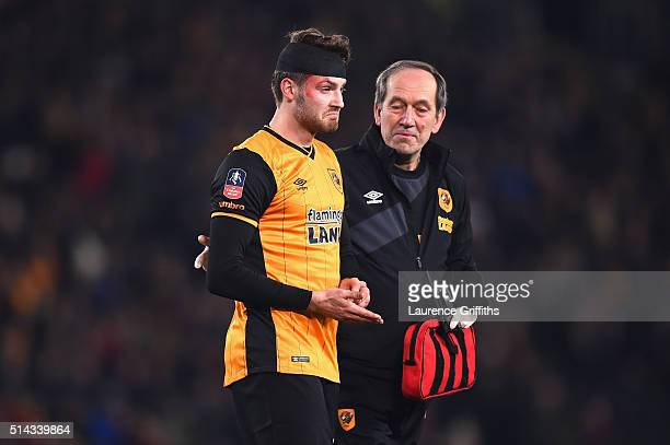 Nick Powell of Hull City walks with his head bandaged after a clash of heads with Per Mertesacker of Arsenal during the Emirates FA Cup Fifth Round...