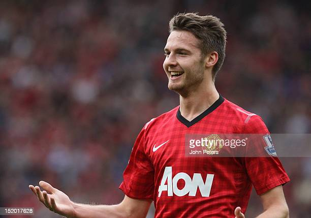 Nick Powell of Manchester United celebrates scoring their fourth goal during the Barclays Premier League match between Manchester United and Wigan...