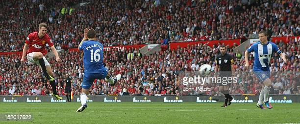 Nick Powell of Manchester United scores their fourth goal during the Barclays Premier League match between Manchester United and Wigan Athletic at...