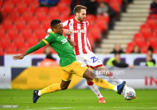Nick Powell of Stoke City shoots as he is challenged by Darnell Fisher of Preston North End during the Sky Bet Championship match between Stoke City...