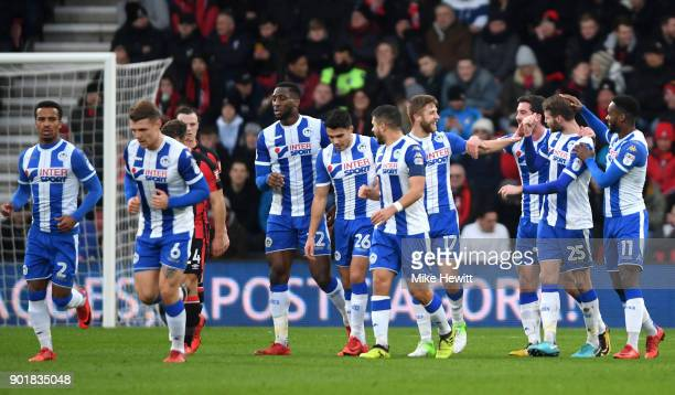 Nick Powell of Wigan Athletic is congratulated by team mates as they celebrate the own goal scored by Emerson Hyndman of AFC Bournemouth during The...