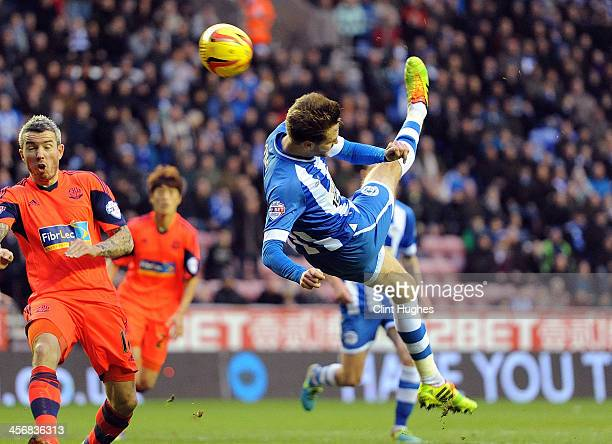 Nick Powell of Wigan Athletic scores the second goal of the game for his side during the Sky Bet Championship match between Wigan Athletic and Bolton...