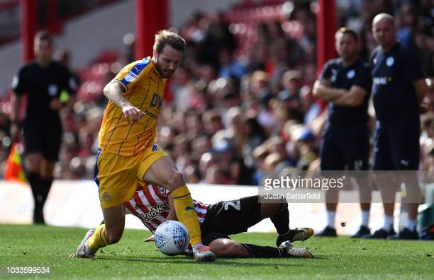 Nick Powell of Wigan is tackled by Said Benrahma of Brentford during the Sky Bet Championship match between Brentford and Wigan on September 15 2018...