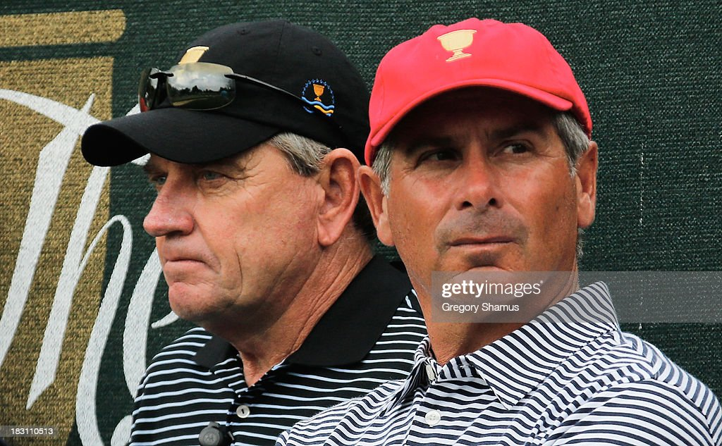 Nick Price (L) Captain of the International Team and Fred Couples the Captain of the U.S. team watch the action on eighth hole during the Day Two Foursome Matches at the Muirfield Village Golf Club on October 4, 2013 in Dublin, Ohio.