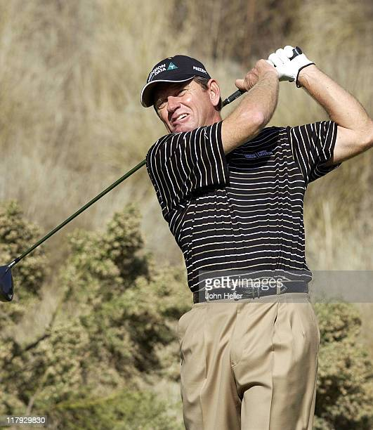 Nick Price drives his ball off the fourteenth tee during the third round of play at the Target World Challenge.