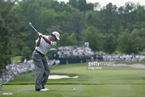 Nick Price hits his tee shot on the par 3 6th hole during the third round of the Wachovia Championship on May 10 2003 at the Quail Hollow Club in...
