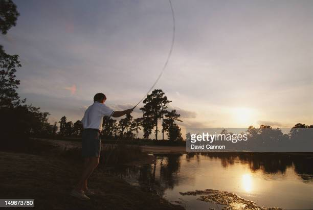 Nick Price of Zimbabwe casts a line whilst fishing on 1st February 1994 at the Lake Nona Golf Club in Orlando, Florida, United States.