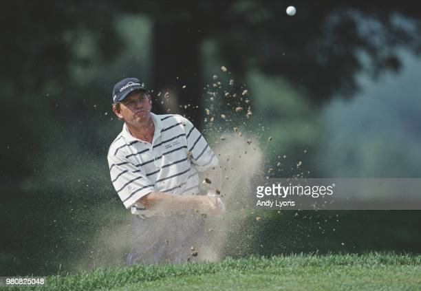 Nick Price of Zimbabwe keeps his eye on the ball as he hits out of the bunker during the Advil Western Open golf tournament on 9 July 2000 at the Cog...