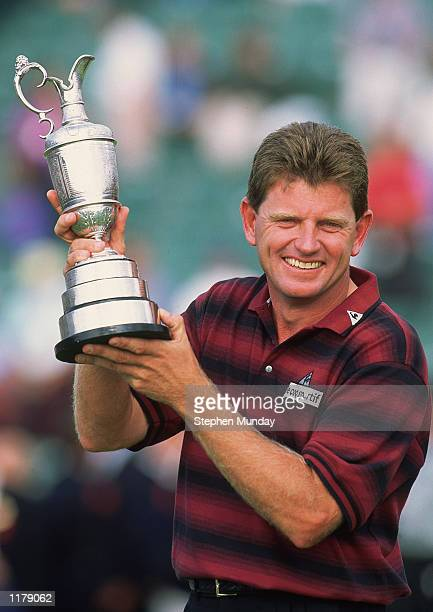 Nick Price of Zimbabwe lifts the Claret Jug after winning the British Open on the Ailsa Course at Turnberry in Ayr, Scotland on July 17, 1994.