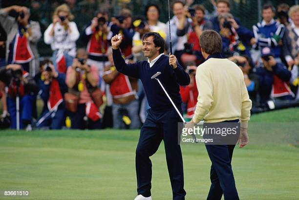 Nick Price of Zimbabwe looks on as Spanish golfer Severiano Ballesteros celebrates his final putt on the 18th green during the Open Championship at...