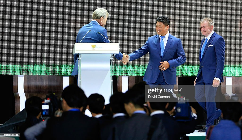 Nick Price of Zimbabwe the International team captain shakes hands with his vice-captain K.J.Choi of South Korea as assistant captain Tony Johnstone of Zimbabwe looks on during the opening ceremony of the 2015 Presidents Cup at the Convensia Ceremony Hall on October 7, 2015 in Incheon City, South Korea.