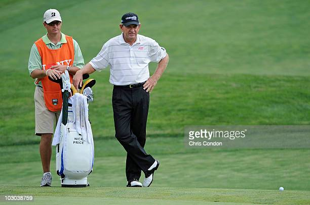 Nick Price of Zimbabwe waits with his caddie to putt during the first round of the Dick's Sporting Goods Open at En-Joie Golf Course on June 25, 2010...
