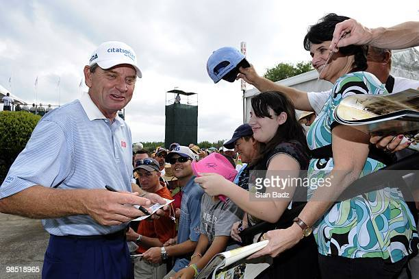 Nick Price signs autographs for fans during the second round of the Outback Steakhouse Pro-Am at TPC Tampa Bay on April 17, 2010 in Lutz, Florida.
