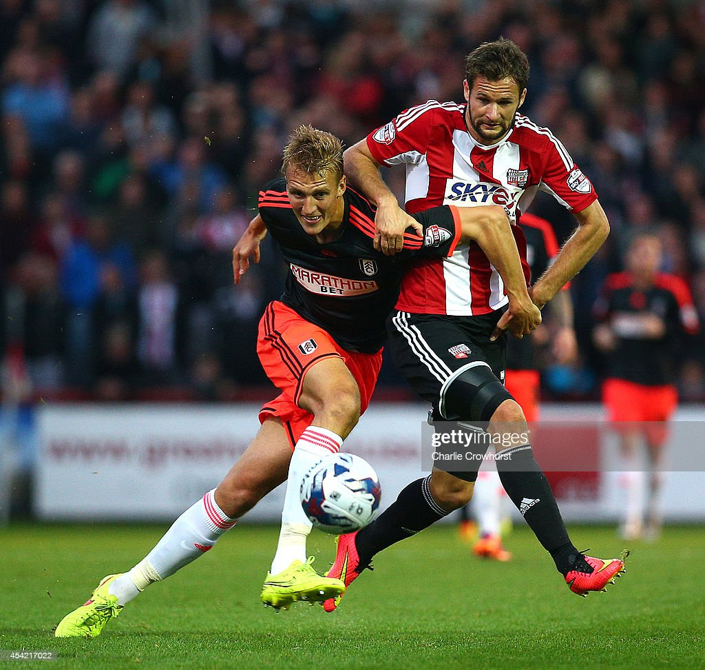 Nick Proschwitz of Brentford looks to get past Fulham's Dan Burn during the Capital One Cup Second Round match between Brentford and Fulham at Griffin Park on August 26, 2014 in London, England.