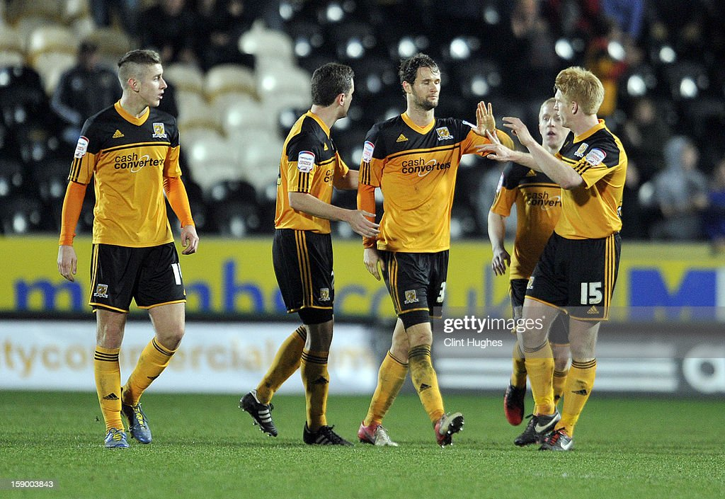 Nick Proschwitz (3 left) of Hull City celebrates with his team-mates after he scores the equalizing goal of the game for his side during the FA Cup with Budweiser Third Round match between Hull City and Leyton Orient at the KC Stadium on January 5, 2013 in Hull, England