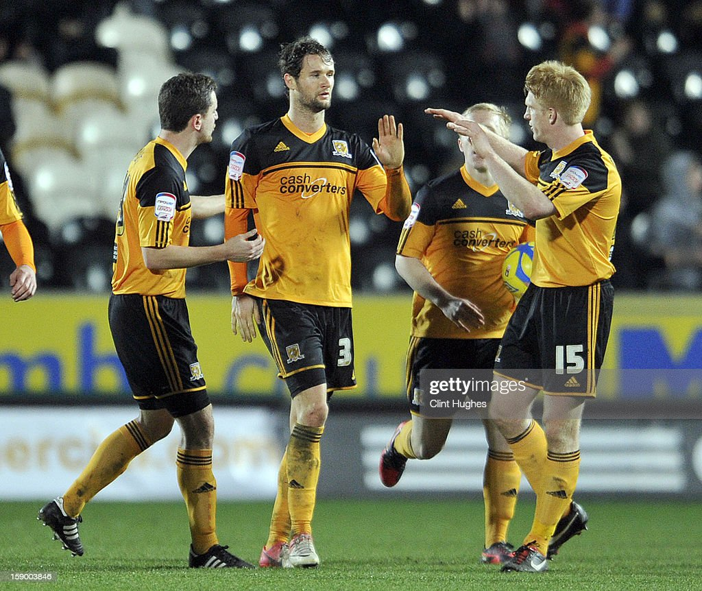 Nick Proschwitz (2 left) of Hull City celebrates with his team-mates after he scores the equalizing goal of the game for his side during the FA Cup with Budweiser Third Round match between Hull City and Leyton Orient at the KC Stadium on January 5, 2013 in Hull, England