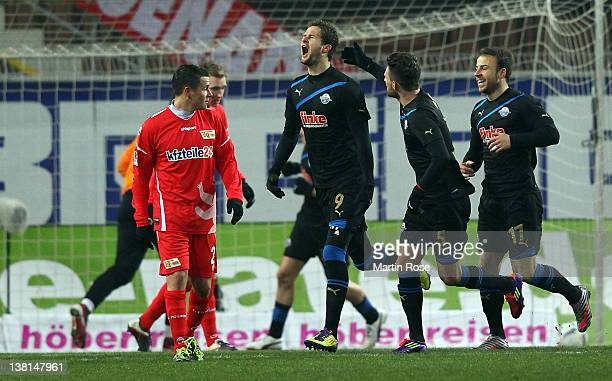 Nick Proschwitz of Paderborn celebrate with his team mates after he scores the opening goal during the Second Bundesliga match between SC Paderborn...