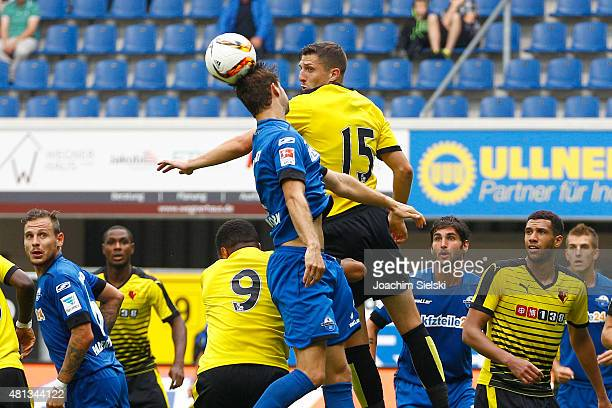 Nick Proschwitz of Paderborn challenges Craig Cathcart of Watford during the preseason friendly match between SC Paderborn and Watford FC at Benteler...