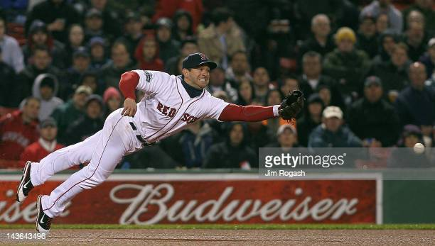 Nick Punto of the Boston Red Sox is unable to field a ball hit by Kurt Suzuki of the Oakland Athletics at Fenway Park May 1 2012 in Boston...