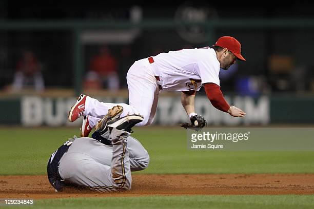Nick Punto of the St Louis Cardinals as he tags out Carlos Gomez of the Milwaukee Brewers attempting to steal in the top of the seocnd inning during...