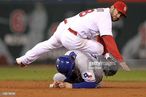 Nick Punto of the St Louis Cardinals turns the double play as Ian Kinsler of the Texas Rangers slides into second base in the sixth inning during...