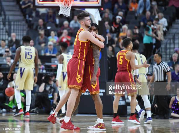 Nick Rakocevic of the USC Trojans hugs teammate Kevin Porter Jr #4 after he hit a 3pointer against the Washington Huskies at the end of the first...