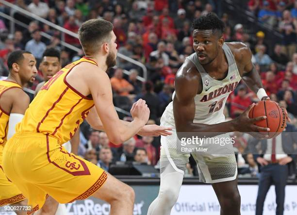 Nick Rakocevic of the USC Trojans guards Deandre Ayton of the Arizona Wildcats during the championship game of the Pac12 basketball tournament at...