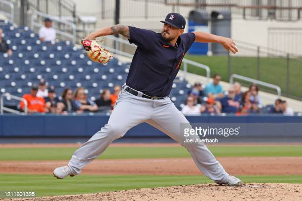 Nick Ramirez of the Detroit Tigers throws the ball against the Houston Astros during a spring training game at the FITTEAM Ballpark of the Palm...
