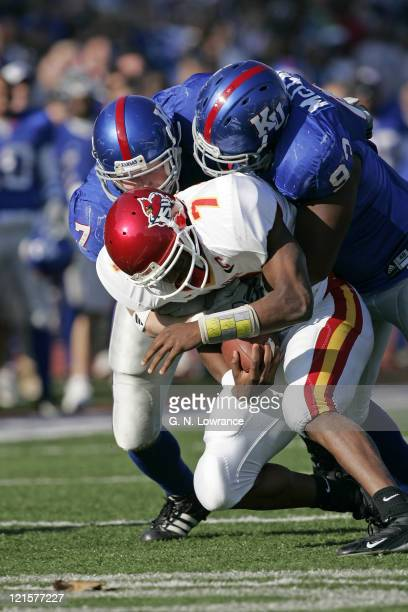 Nick Reid and James McClinton of the Kansas Jayhawks bring down Bret Meyer during 4thquarter action against the Iowa State Cyclones at Memorial...