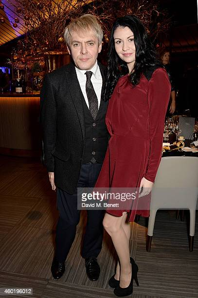Nick Rhodes and girlfriend Nefer Suvio attend the GQ Christmas Lunch at Quaglino's on December 9 2014 in London England