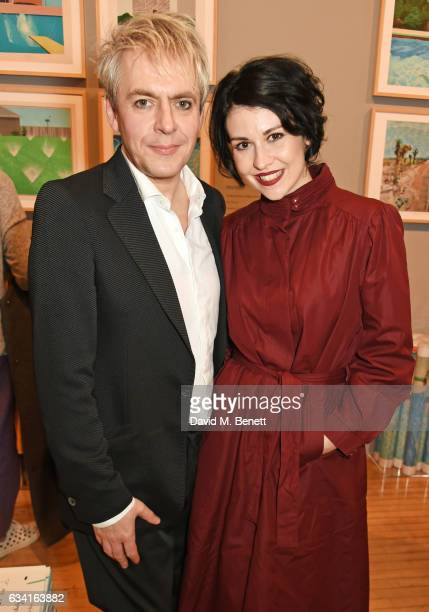 Nick Rhodes and Nefer Suvio attend a private view of the David Hockney retrospective at the Tate Britain on February 7 2017 in London England
