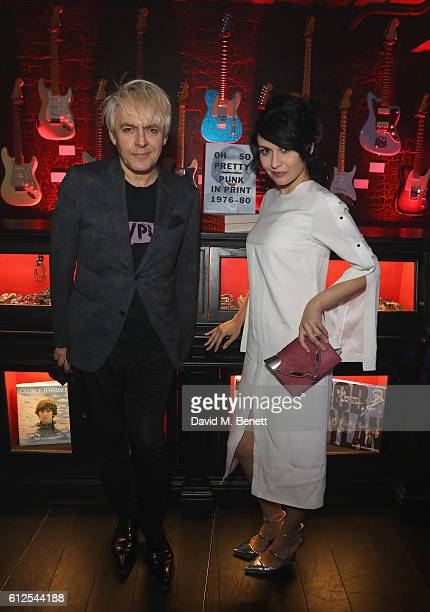 Nick Rhodes and Nefer Suvio attend the John Varvatos x Oh So Pretty Punk In Print Opening Night on October 4 2016 in London England