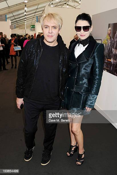 Nick Rhodes and Nefer Suvio attends a VIP Preview of the Frieze Art Fair in Regent's Park on October 10 2012 in London England