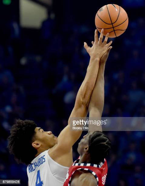 Nick Richards of the Kentucky Wildcats and Tai Odiase of the IllinoisChicago Flames battle for the ball during the tipoff to the game between the...