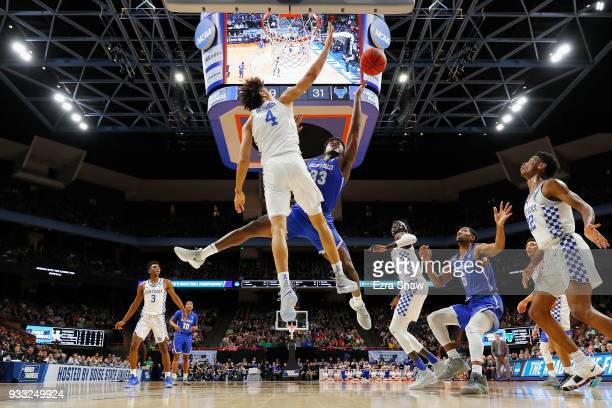 Nick Richards of the Kentucky Wildcats blocks a shot by Nick Perkins of the Buffalo Bulls during the first half in the second round of the 2018 NCAA...