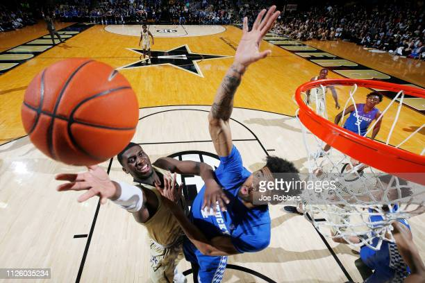 Nick Richards of the Kentucky Wildcats defends against Simisola Shittu of the Vanderbilt Commodores in the second half of the game at Memorial Gym on...