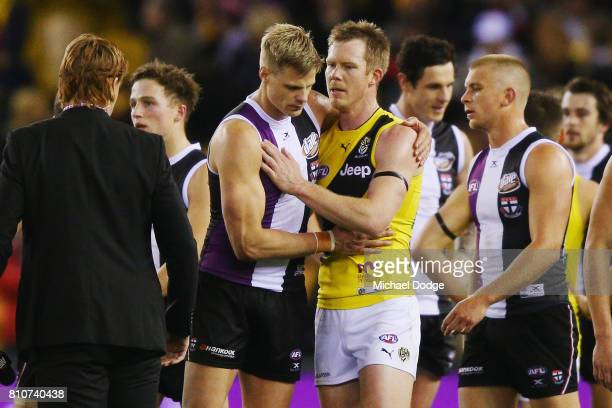 Nick Riewoldt of the Saints and Jack Riewoldt of the Tigers embrace after the round 16 AFL match between the St Kilda Saints and the Richmond Tigers...