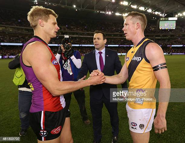 Nick Riewoldt of the Saints and Jack Riewoldt of the Tigers shake hands after the final siren during the round 16 AFL match between the St Kilda...