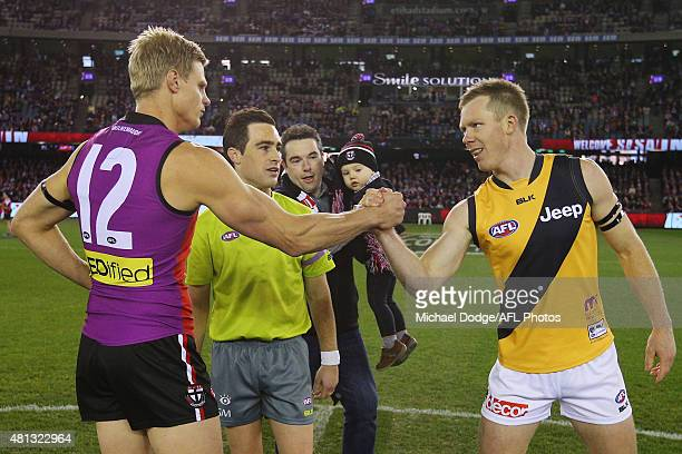Nick Riewoldt of the Saints and Jack Riewoldt of the Tigers shake hands after the coin toss during the round 16 AFL match between the St Kilda Saints...