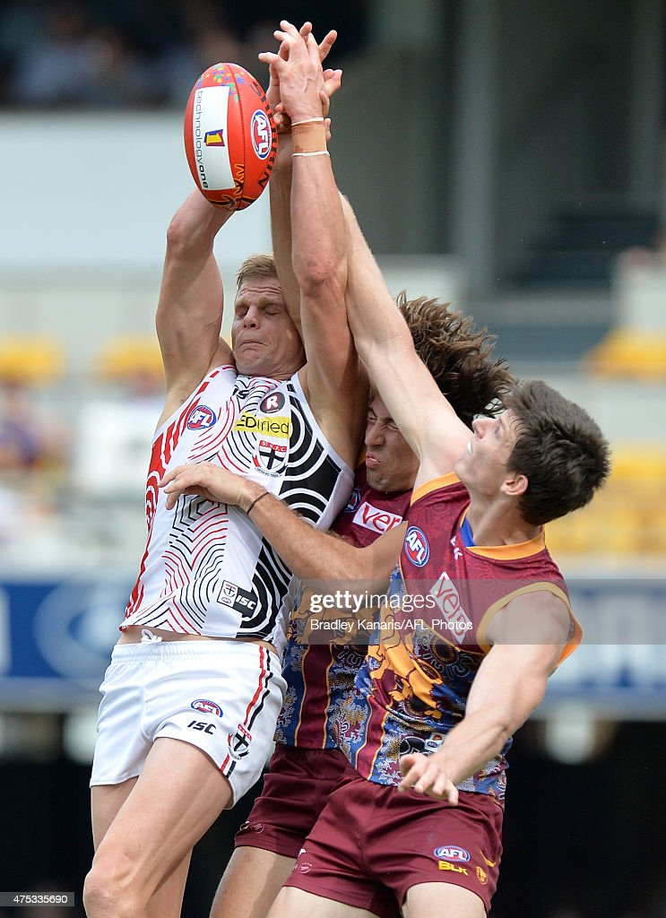 Nick Riewoldt of the Saints and Marco Paparone of the Lions compete for the mark during the round nine AFL match between the Brisbane Lions and the St Kilda Saints at The Gabba on May 31, 2015 in Brisbane, Australia.