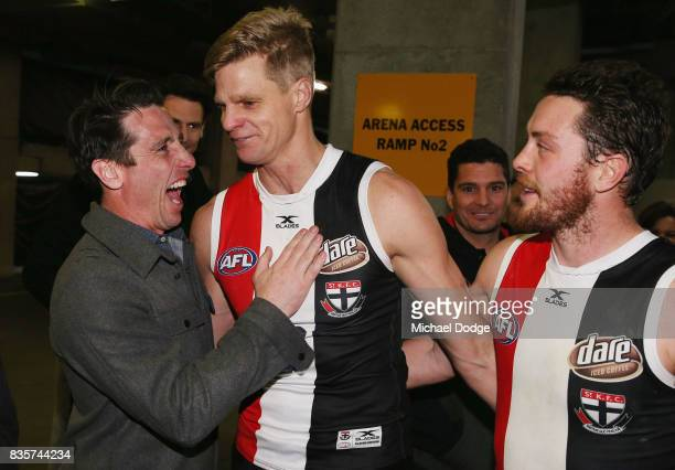 Nick Riewoldt of the Saints celebrates with former teammate Stephen Milne after winning during the round 22 AFL match between the St Kilda Saints and...