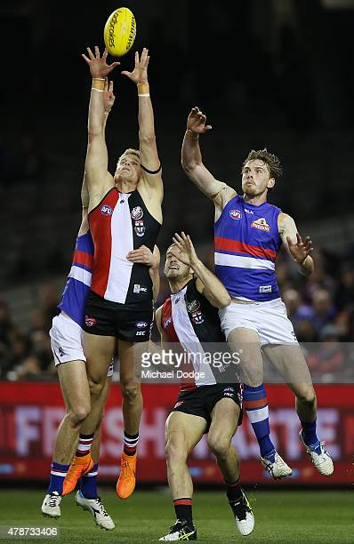 Nick Riewoldt of the Saints competes for the ball against Jordan Roughead of the Bulldogsduring the round 13 AFL match between the St Kilda Saints...