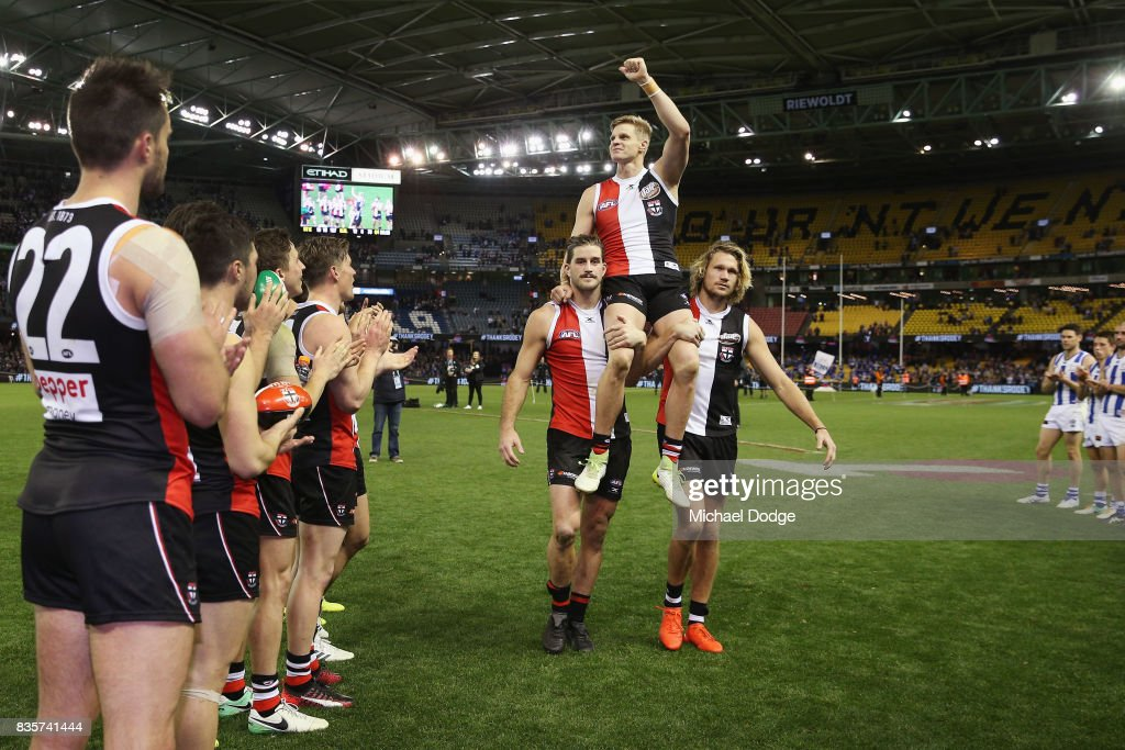 Nick Riewoldt of the Saints gets carried off by Josh Bruce (L) and Sam Gilbert for his last home match during the round 22 AFL match between the St Kilda Saints and the North Melbourne Kangaroos at Etihad Stadium on August 20, 2017 in Melbourne, Australia.