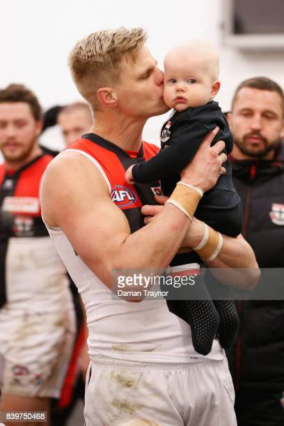 Nick Riewoldt of the Saints holds his son William in the rooms after the round 23 AFL match between the Richmond Tigers and the St Kilda Saints at...