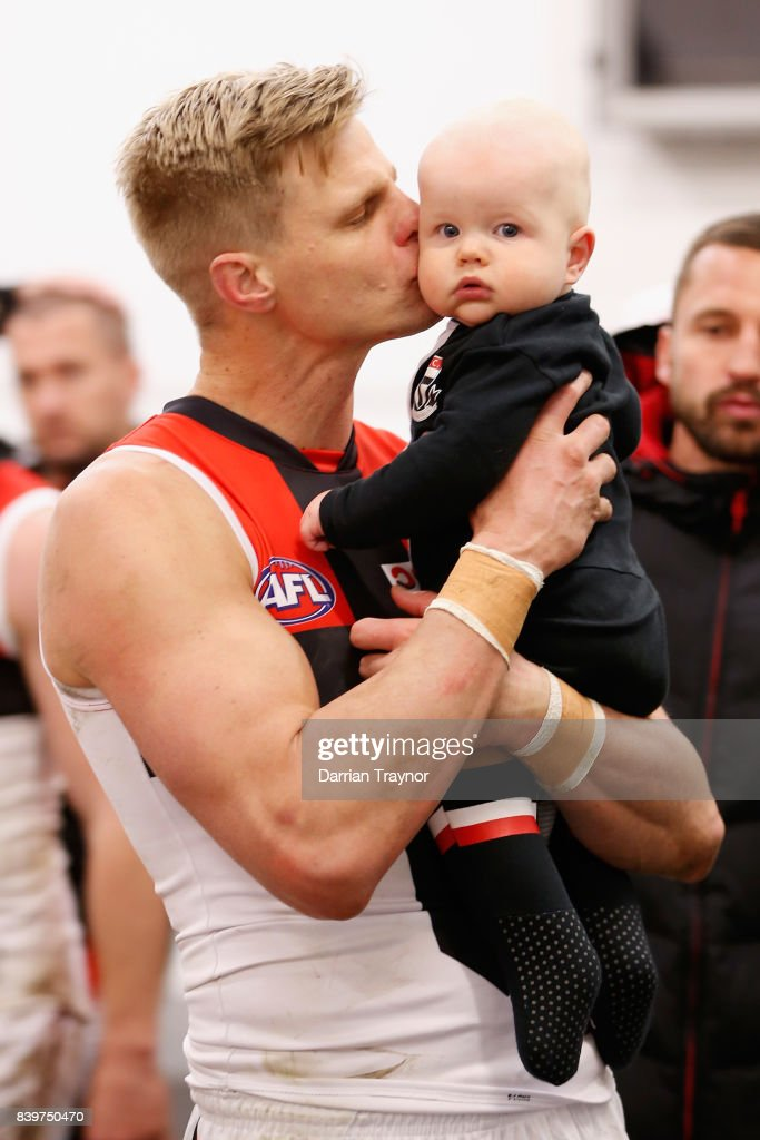 Nick Riewoldt of the Saints holds his son William in the rooms after the round 23 AFL match between the Richmond Tigers and the St Kilda Saints at Melbourne Cricket Ground on August 27, 2017 in Melbourne, Australia.