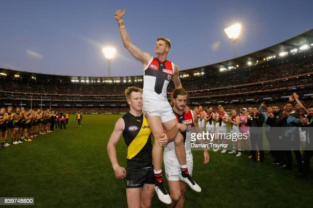 Nick Riewoldt of the Saints is chaired off in his final game after the round 23 AFL match between the Richmond Tigers and the St Kilda Saints at...